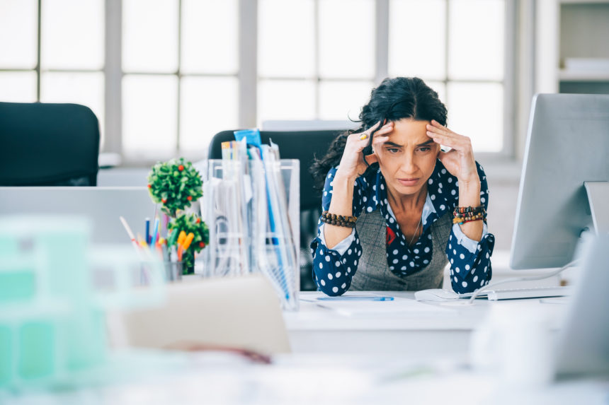 Stressed woman sitting at desk